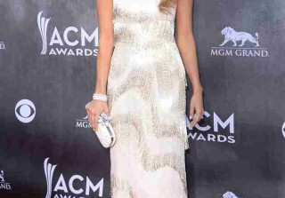 Pregnant Carrie Underwood Debuts Her Baby Bump — On Stage! (VIDEO)