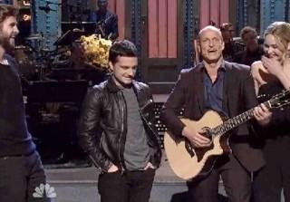 Watch Jennifer Lawrence, Liam Hemsworth, Josh Hutcherson Crash Woody Harrelson\'s SNL Monologue (VIDEO)