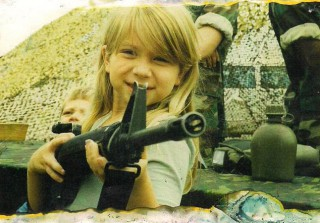 This Gun-Toting Kid Is Now a Bravo Star, But Who Is She? (PHOTOS)