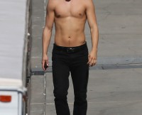 Derek Hough goes topless as he walks around the 'Dancing With The Stars' set in Hollywood, CA