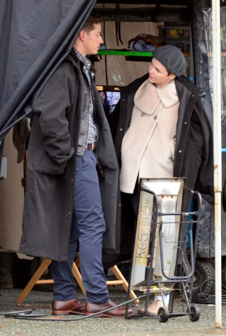 Ginnifer Goodwin is seen sporting what appears to be a small baby bump as fiance Josh Dallas touches her belly on the set of 'Once Upon a Time' earlier this month