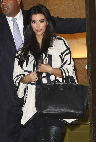 """Kourtney and Kim Kardashian arrive in New York with their husbands, Scott Disick and Kris Humphries, to being filming season two of their hit show, """"Kourtney and Kim Take New York"""""""