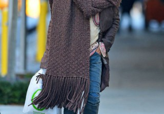 Which Fashion-Forward Rock Superstar Was Spotted Wearing the Biggest Scarf on the Planet? (PHOTO)